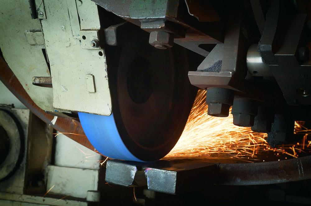 Abrasive belt tensioning: Overlooked and under-addressed
