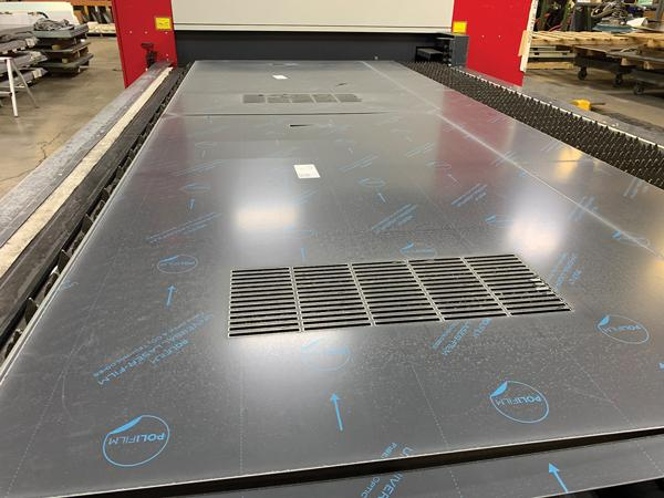 Automatic nesting and part labeling help increase manufacturer's