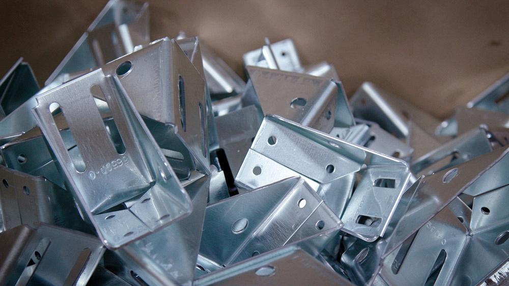 How metalworking manufacturers decide whether to fabricate or stamp
