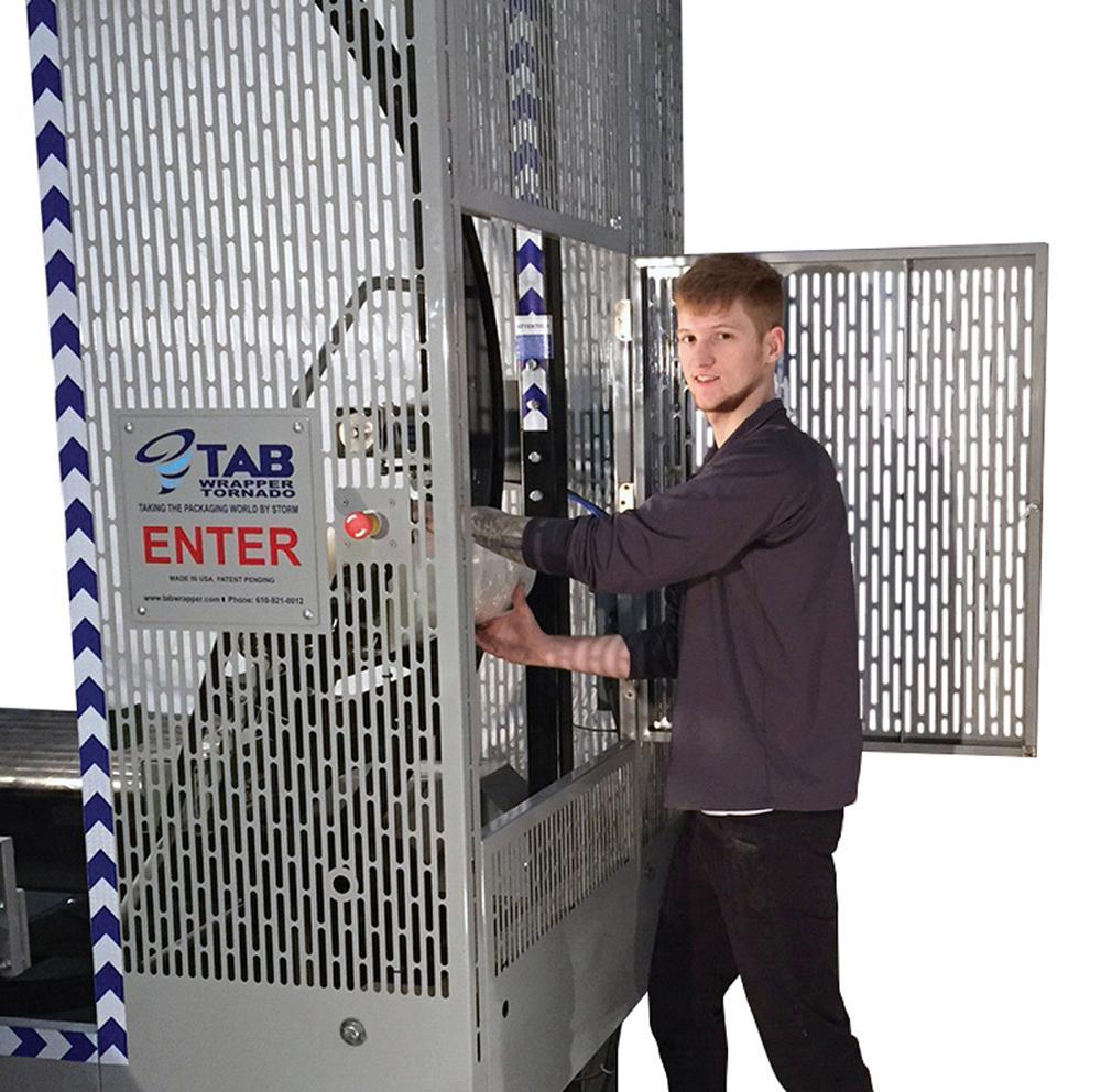 Orbital wrapper permits plastic film change without entering machine