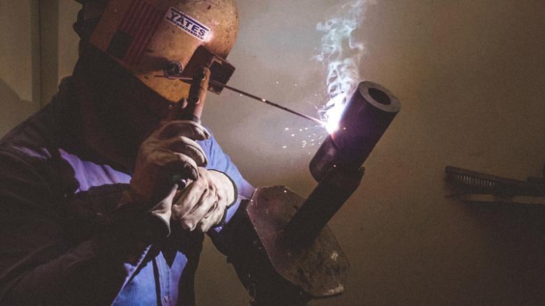 Pipe welding student stick welding