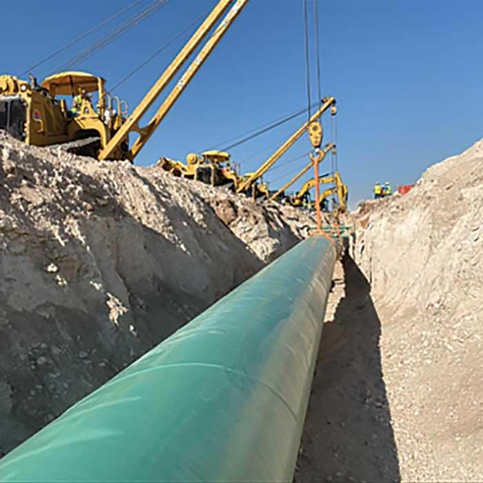 Cranes laying pipelines